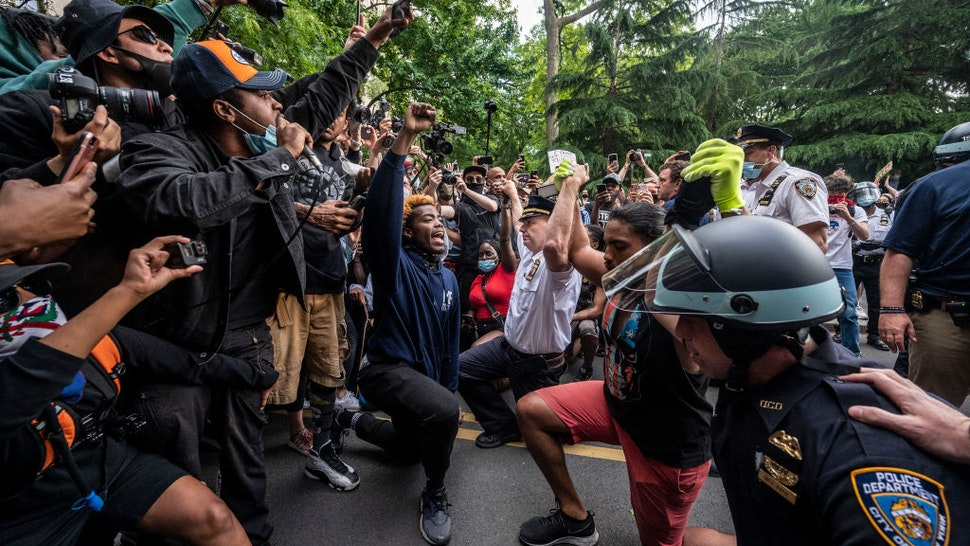 New York, N.Y.: Chief of Department of the New York City Police, Terence Monahan, takes a knee with activists as protesters paused while walking in Manhattan on June 1, 2020.