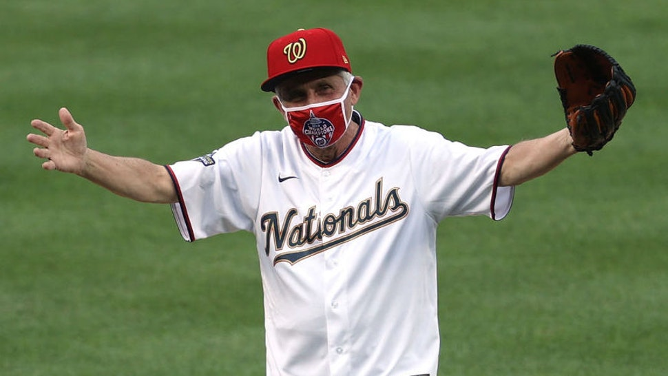 Dr. Anthony Fauci, director of the National Institute of Allergy and Infectious Diseases reacts after throwing out the ceremonial first pitch prior to the game between the New York Yankees and the Washington Nationals at Nationals Park on July 23, 2020 in Washington, DC.
