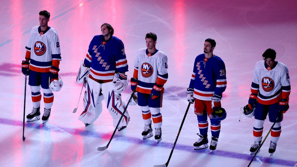 The New York Islanders and the New York Rangers stand together as the Canadian and American national anthems are played before the start of an exhibition game prior to the 2020 NHL Stanley Cup Playoffs at Scotiabank Arena on July 29, 2020 in Toronto, Ontario.