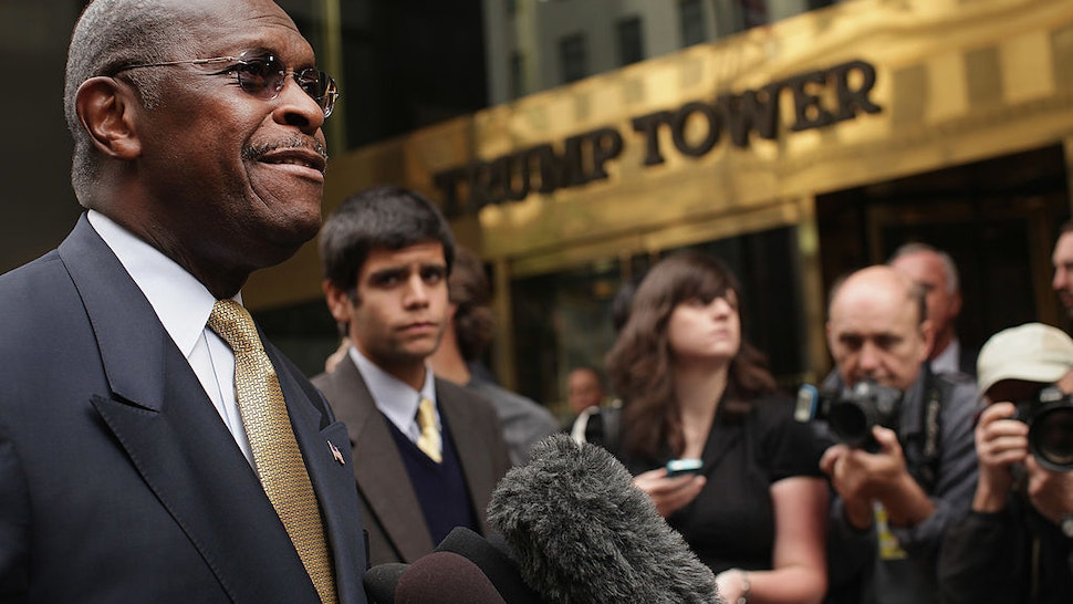Republican presidential candidate Herman Cain speaks to the media outside of Trump Towers before a scheduled appearance with real estate mogul Donald Trump on October 3, 2011 in New York City.