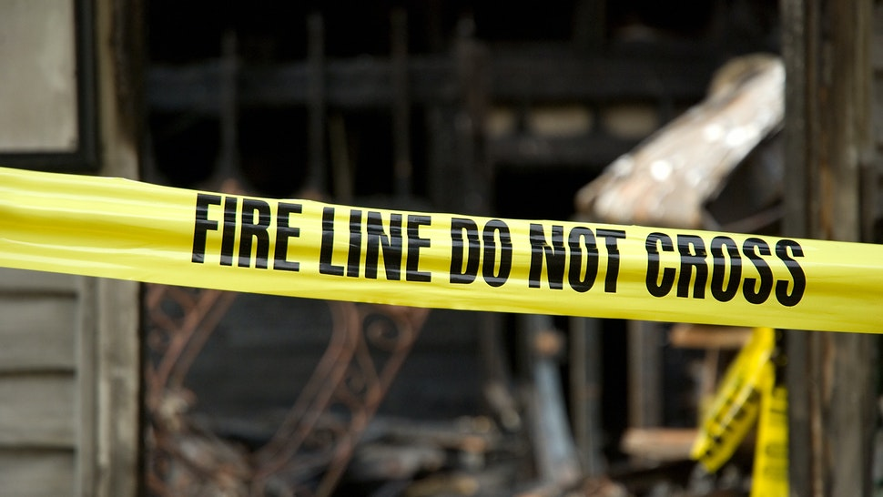 Fire line in front of a destroyed home.