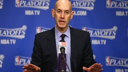 Adam Silver the NBA Commissioner talks to the media before the start of the Oklahoma City Thunder game against the Memphis Grizzlies in Game 4 of the Western Conference Quarterfinals during the 2014 NBA Playoffs at FedExForum on April 26, 2014 in Memphis, Tennessee.