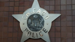 CHICAGO, IL - DECEMBER 01: A Chicago police badge hangs in front of the City of Chicago Public Safety Headquarters on December 1, 2015 in Chicago, Illinois. Following public outcry over the way police handled the shooting death of Laquan McDonald by Chicago police officer Jason Van Dyke, Mayor Rahm Emanuel today announced he had fired Chicago Police Superintendant Garry McCarthy. McCarthy, Emanuel and Cook County States Attorney Anita Alvarez have been accused of trying to cover up the shooting. (Photo by Scott Olson/Getty Images)