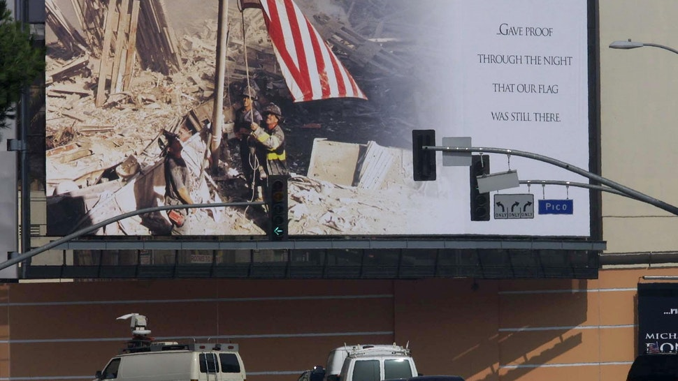 A huge mural showing a picture of firefighters raising the US flag over the ruins of the World Trade Center is displayed outside the 20th Century Fox Studio in Los Angeles 21 September 2001.