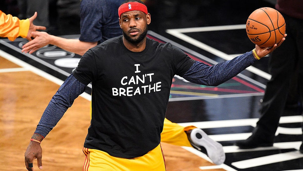 Cleveland Cavaliers forward LeBron James (23) wears a t shirt to honor Eric Garner during warmups before a NBA game between the Cleveland Cavaliers and the Brooklyn Nets at Barclays Center in Brooklyn, NY The Cleveland Cavaliers defeated the Brooklyn Nets 110-88.
