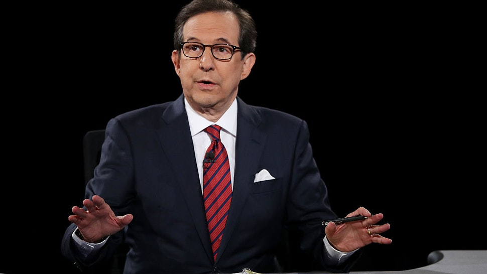 Fox News anchor and moderator Chris Wallace asks the candidates a question during the third U.S. presidential debate at the Thomas & Mack Center on October 19, 2016 in Las Vegas, Nevada.