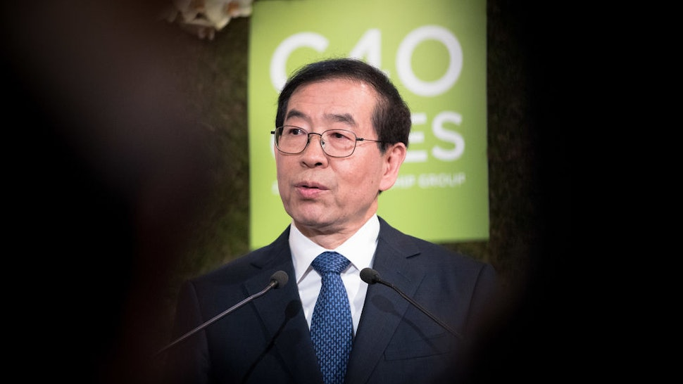 Mayor of Seoul, Park Won soon delivers a speech next to the Mayor of London, Sadiq Khan (not pictured) and Mayor of Paris and Head of C40 (a grouping of 90 megacities that want to act for the climate), Anne Hidalgo (not pictured) at the City Hall on March 29, 2017 in Paris, France.