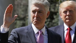 U.S. Supreme Court Associate Justice Judge Neil Gorsuch takes the judicial oath as President Donald Trump looks on during a ceremony in the Rose Garden at the White House April 10, 2017 in Washington, DC.