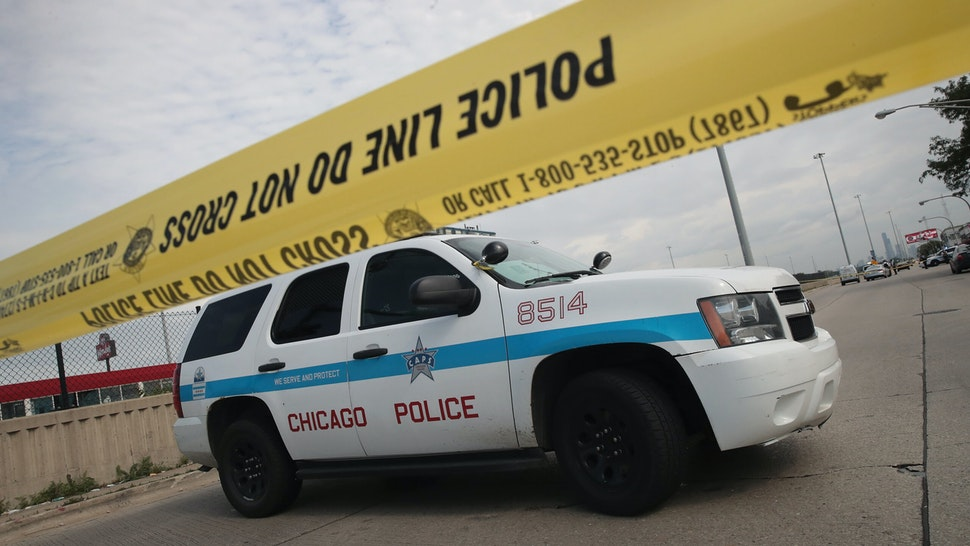 CHICAGO, IL - JUNE 30: Police investigate the murder of a young man found shot to death in the back seat of a bullet-riddled car on June 30, 2017 in Chicago, Illinois. More than 300 people have been killed and more than 1700 wounded by gunfire in Chicago this year. On June 1, a task force was formed by the Chicago police, Illinois state police and the ATF to combat the gun violence in the city. ATF has formed similar task forces on a temporary basis to fight regional spikes in gun violence. Chicago's task force is the only one in the nation formed with the idea to be permanent. (Photo by Scott Olson/Getty Images)