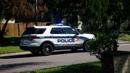 A police patrol car drives through a residential neighborhood announcing over the loud speaker that a mandatory evacuation has been issued for the area ahead of Hurricane Irma on September 09, 2017 in St. Petersburg, Florida.