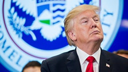 U.S. President Donald Trump listens while participating in a Customs and Border Protection (CBP) roundtable discussion after touring the CBP National Targeting Center February 2, 2018 in Sterling, Virginia.