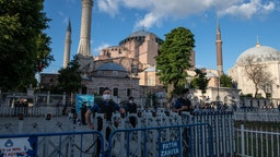 ISTANBUL, TURKEY - JULY 10: Police officers stand guard outside Istanbul's famous Hagia Sophia on July 10, 2020 in Istanbul, Turkey. Turkey's top administrative court ruled to annul a 1934 decree that turned the historic Hagia Sophia into a museum. The controversial ruling opens the way for the structure to be converted back into a mosque after 85 years. President Recep Tayyip Erdoğan handed over the iconic structure's control to the country's Religious Affairs Directorate following a court ruling revoking its status as a museum. President Erdogan said that the government will open Istanbul's Hagia Sophia for worship on July 24. (Photo by Burak Kara/Getty Images)