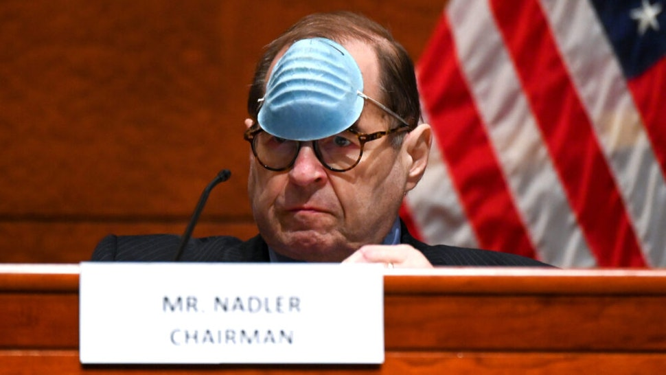 """WASHINGTON, DC - JUNE 17: Representative Jerry Nadler, a Democrat from New York and chairman of the House Judiciary Committee, adjusts his mask to drink a beverage during a markup on H.R. 7120, the """"Justice in Policing Act of 2020,"""" on June 17, 2020, in Washington, D.C. The House bill would make it easier to prosecute and sue officers and would ban federal officers from using choke holds, bar racial profiling, end """"no-knock"""" search warrants in drug cases, create a national registry for police violations, and require local police departments that get federal funds to conduct bias training."""
