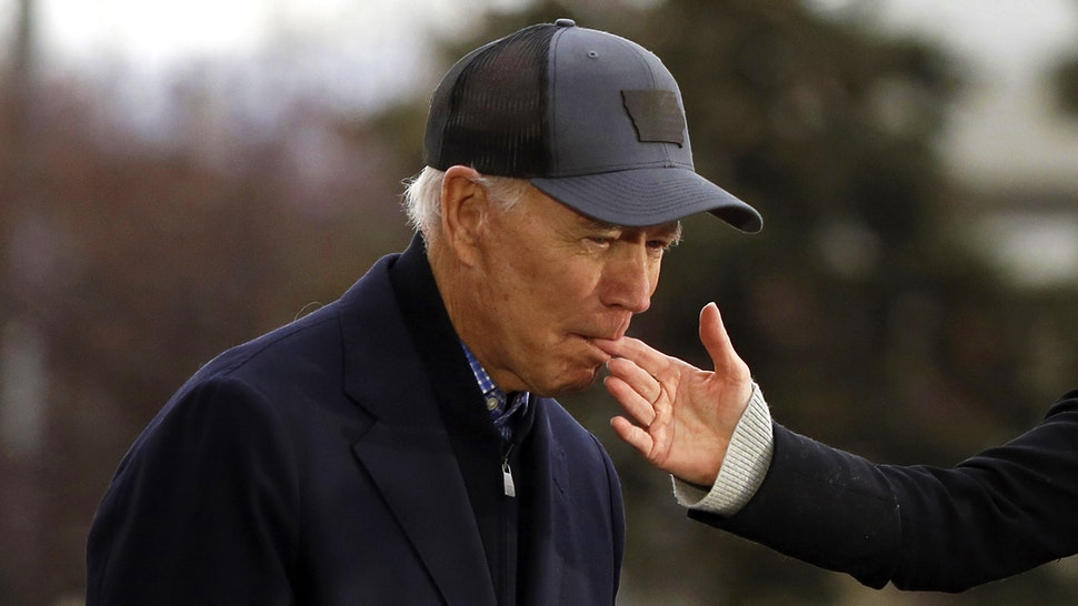 COUNCIL BLUFFS, IA - NOVEMBER 30: Democratic presidential candidate, former Vice President Joe Biden bites the finger of his wife Jill Biden as she introduces him during a campaign event on November 30, 2019 in Council Bluffs, Iowa. Biden, who begins his eight-day bus tour across Iowa on Saturday, once lead the state in the polls but now trails presidential candidates Pete Buttigieg and Elizabeth Warren with just under 3 months until the 2020 Iowa Democratic caucuses.