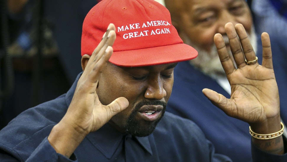 WASHINGTON, DC - OCTOBER 11: (AFP OUT) Rapper Kanye West speaks during a meeting with U.S. President Donald Trump in the Oval office of the White House on October 11, 2018 in Washington, DC.