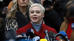 Actress Rose McGowan speaks with members of the media after former Weinstein Co. Co-Chairman Harvey Weinstein arrives at state supreme court in New York, U.S., Monday, Jan. 6, 2020. Weinstein's criminal trial, on five felony counts, including predatory sexual assault and rape, is scheduled to begin on Monday in state court in Manhattan. Jury selection could last two weeks, the trial six more.