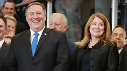 WASHINGTON, DC - MAY 01: U.S. Secretary of State Mike Pompeo (L) and his wife Susan Pompeo are welcomed to the State Department during a ceremony in the lobby of the Harry S. Truman Building May 1, 2018 in Washington, DC. Serving as director of the Central Intelligence Agency until he was sworn in as Secretary of State on April 26, Pompeo traveled to Israel, Jordan and Saudi Arabia before coming to State Department headquarters on Tuesday. (Photo by Chip Somodevilla/Getty Images)