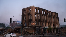 The shell of a building that was burnt during the earlier fires sits still smoldering in Minneapolis, United States, on May 29, 2020. Protests continued following the death of George Floyd, who died after being restrained by Minneapolis police officers on Memorial Day. (Photo by Zach D Roberts/NurPhoto via Getty Images)