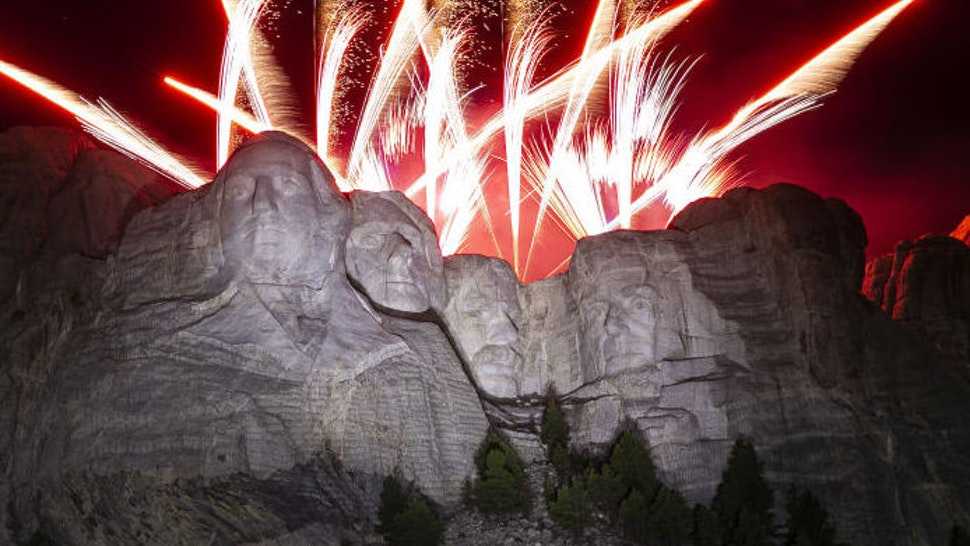 Fireworks explode during an event at Mount Rushmore National Memorial in Keystone, South Dakota, U.S., on Friday, July 3, 2020.The early Independence Day celebration, which will feature a military flyover and the first fireworks in more than a decade, is expected to include about 7,500 ticketed guests who won't be required to wear masks or socially distance despite a spike in U.S. coronavirus cases. Photographer: Al Drago/Bloomberg