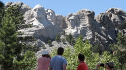 Tourists visit Mount Rushmore National Monument on July 01, 2020 in Keystone, South Dakota. President Donald Trump is expected to visit the monument and make remarks before the start of a fireworks display on July 3. (Photo by Scott Olson/Getty Images)