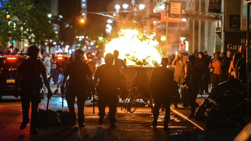 NEW YORK, NY - MAY 31: Protesters set a dumpster on fire on May 31, 2020 in New York City. Major cities across the United States have seen increased protests against police brutality and civil unrest since the death of George Floyd while in Minneapolis police custody.