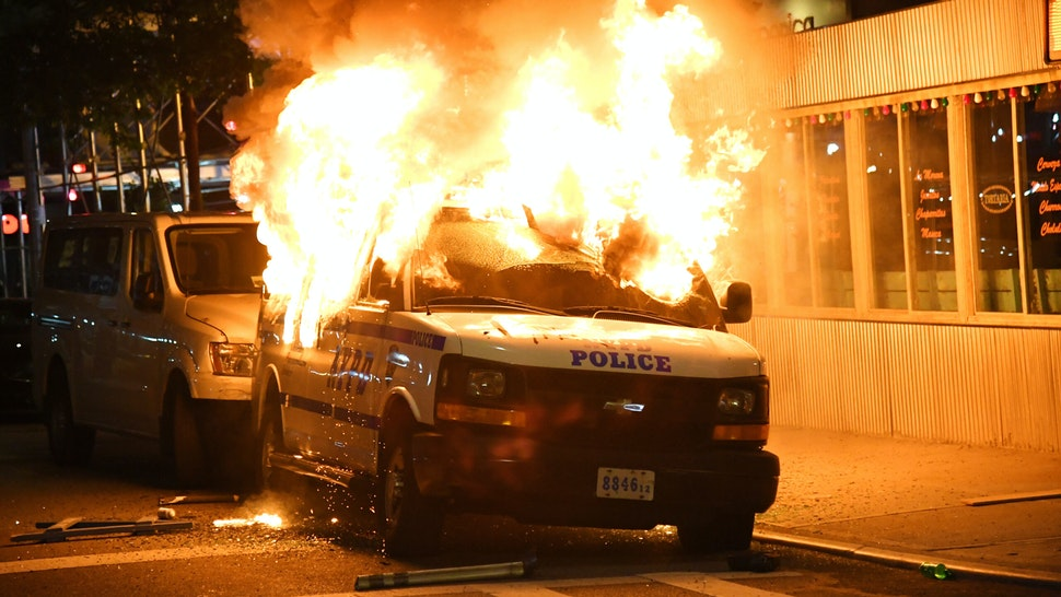 NEW YORK, NEW YORK - MAY 30: FDNY Firefighters work to put out fires on NYPD vehicles caused by protesters near Union Square who are protesting the recent killing of George Floyd on May 30, 2020 in New York City. Demonstrations are being held across the US after George Floyd died in police custody on May 25th.