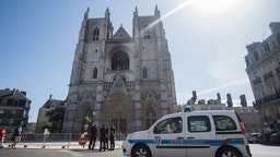 Firefighters stand in front of Saint-Pierre-et-Saint-Paul cathedral in Nantes, western France, on July 20, 2020, two days after a fire broke out in three places at the gothic cathedral of Nantes in western France, destroying stained glass windows and the grand organ and sparking an arson investigation. (Photo by Loic VENANCE / AFP) (Photo by LOIC VENANCE/AFP via Getty Images)