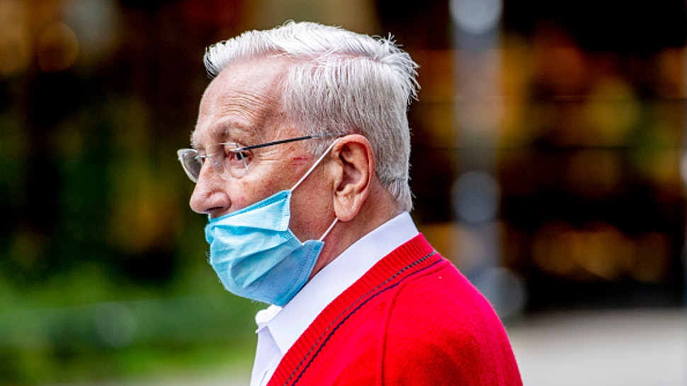 ROTTERDAM, NETHERLANDS - 2020/07/28: An elderly man wearing his facemask below his nose seen walking on the street. Amid concerns about an increase in coronavirus infections throughout the country, more and more people start to pay more attention to social distancing and wearing a facemask. The Outbreak Management Team (OMT), who had advised the government on the fight against the coronavirus, said that the facemask need to become mandatory in shops and indoor spaces where people gather in order to fight the spread of the Coronavirus (Covid-19). The Government heard their advice and facemasks will become compulsory starting from Saturday 1st August, 2020 in shops and other indoor spaces.