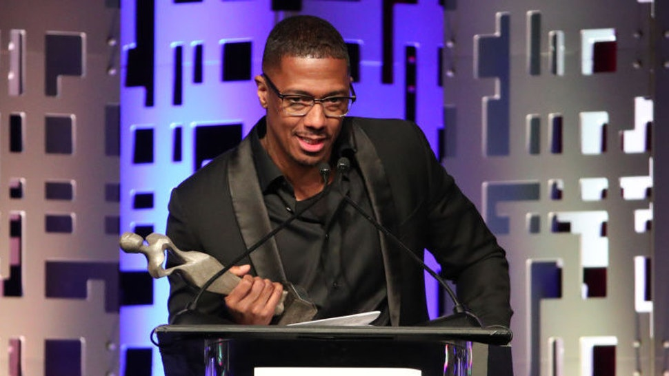 Host Nick Cannon accepts the Anne Douglas Award on behalf of Kevin and Eniko Hart onstage at The Los Angeles Mission Legacy Of Vision Gala at The Beverly Hilton Hotel on October 24, 2019 in Beverly Hills, California. (Photo by Rich Fury/Getty Images)
