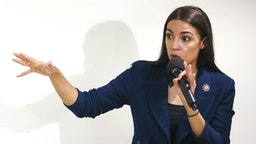 NEW YORK, NY - OCTOBER 03: U.S. Rep. Alexandria Ocasio-Cortez (D-NY) speaks during a town hall meeting at the LeFrak City Queens Library on October 3, 2019 in the Queens borough of New York City. The event focused on her A Just Society legislation, which targets poverty, affordable housing, and access to federal benefits.