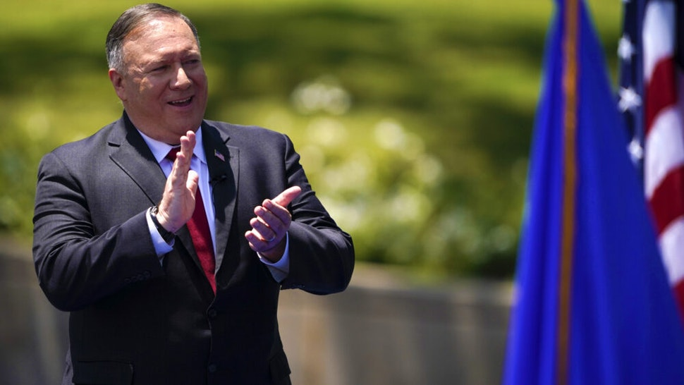 US Secretary of State Mike Pompeo claps as he speaks at the Richard Nixon Presidential Library, July 23, 2020, in Yorba Linda, California.