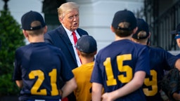 WASHINGTON, DC - JULY 23: U.S. President Donald Trump talks with youth baseball players on the South Lawn of the White House on July 23, 2020 in Washington, DC. President Trump and former New York Yankees Hall of Fame pitcher Mariano Rivera met with youth baseball players to celebrate Opening Day of Major League Baseball. (Photo by Drew Angerer/Getty Images)