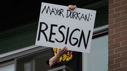 SEATTLE, WA - JUNE 26: A person holds a sign on their balcony as Seattle Mayor Jenny Durkan meets with protesters from the Capitol Hill Organized Protest (CHOP) across the street at First African Methodist Episcopal Church on June 26, 2020 in Seattle, Washington. Earlier in the morning, protesters resisted as city crews attempted to remove barriers at an entrance to CHOP. On Monday, Mayor Durkan said that the city would phase down the CHOP zone and that the Seattle Police Department would return to its vacated East Precinct. (Photo by David Ryder/Getty Images)