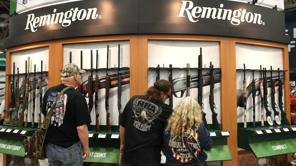 DALLAS, TX - MAY 05: Attendees look at a display of Remington shotguns during the NRA Annual Meeting & Exhibits at the Kay Bailey Hutchison Convention Center on May 5, 2018 in Dallas, Texas. The National Rifle Association's annual meeting and exhibit runs through Sunday. (Photo by Justin Sullivan/Getty Images)