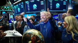 NEW YORK, NY - OCTOBER 28: Sir Richard Branson, Founder of Virgin Galactic, gives the thumbs up after ringing a ceremonial bell on the floor of the New York Stock Exchange (NYSE) to promote the first day of trading of Virgin Galactic Holdings shares on October 28, 2019 in New York City. Virgin Galactic Holdings became the first space-tourism company to go public as it began trading on Monday with a market value of about $1 billion. (Photo by Drew Angerer/Getty Images)