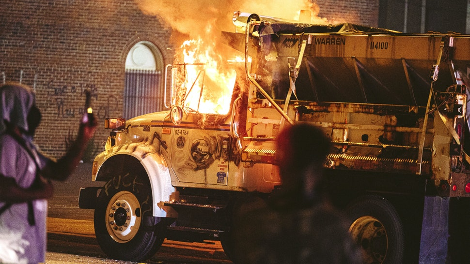 A parked truck is set on fire on July 25, 2020 in Richmond, Virginia. Protesters in Richmond took to the streets to join other protesters around the country for the Stand With Portland rally in support of the Black Lives Matter protesters in Portland, Oregon.