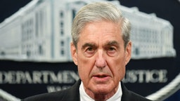 TOPSHOT - Special Counsel Robert Mueller speaks on the investigation into Russian interference in the 2016 Presidential election, at the US Justice Department in Washington, DC, on May 29, 2019. - Special Counsel Robert Mueller said Wednesday that charging Donald Trump with a crime of obstruction was not an option because of Justice Department policy not to indict a sitting president. (Photo by MANDEL NGAN / AFP)