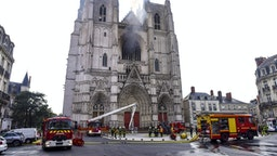 "Firefighters are at work to put out a fire at the Saint-Pierre-et-Saint-Paul cathedral in Nantes, western France, on July 18, 2020. - A blaze that broke inside the gothic cathedral of Nantes on July 18 has been contained, emergency officials said, adding that the damage was not comparable to last year's fire at Notre-Dame cathedral in Paris. ""The damage is concentrated on the organ, which seems to be completely destroyed. Its platform is very unstable and could collapse,"" regional fire chief General Laurent Ferlay told a press briefing in front of the cathedral."