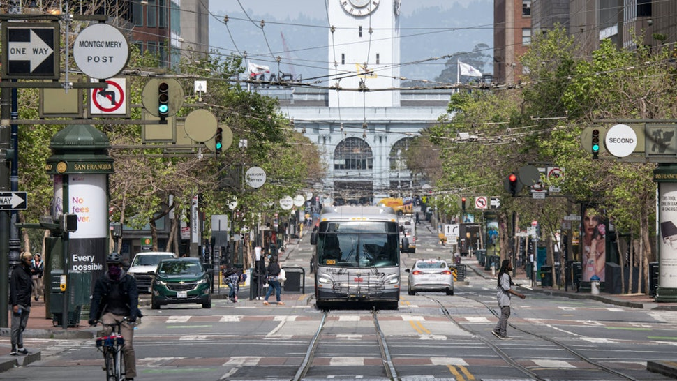 A San Francisco Municipal Transportation Agency (SFMTA) MUNI bus drives on Market Street in San Francisco, California, U.S., on Wednesday, April 8, 2020. Emergency ordinances that passed inSan FranciscoandSan Joseon Tuesday would temporarily extend two weeks' paid sick leave to workers not yet covered under the federal Families First Coronavirus Response Act, that requires employees get paid sick leave for health reasons related to Covid-19.