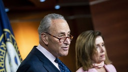 "Senate Minority Leader Chuck Schumer, a Democrat from New York, speaks as U.S. House Speaker Nancy Pelosi, a Democrat from California, right, listens during a news conference at the U.S. Capitol in Washington, D.C., U.S., on Thursday, July 23, 2020. The Trump administration and Senate Republicans have a ""fundamental agreement"" on a GOP plan for another round of virus relief after the White House dropped the idea of including a payroll tax cut."