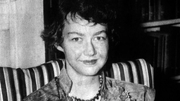 American writer Flannery O'Connor (1925-1964) with her book 'Wise Blood' 1952