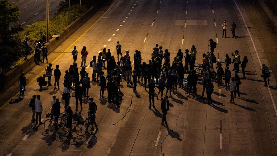Protesters gather on Interstate 5 after marching there from the area known as the Capitol Hill Organized Protest (CHOP) on June 23, 2020 in Seattle, Washington. On Monday, Seattle Mayor Jenny Durkan said that the city would phase down the CHOP zone and that the Seattle Police Department would return to its vacated East Precinct. (Photo by David Ryder/Getty Images)