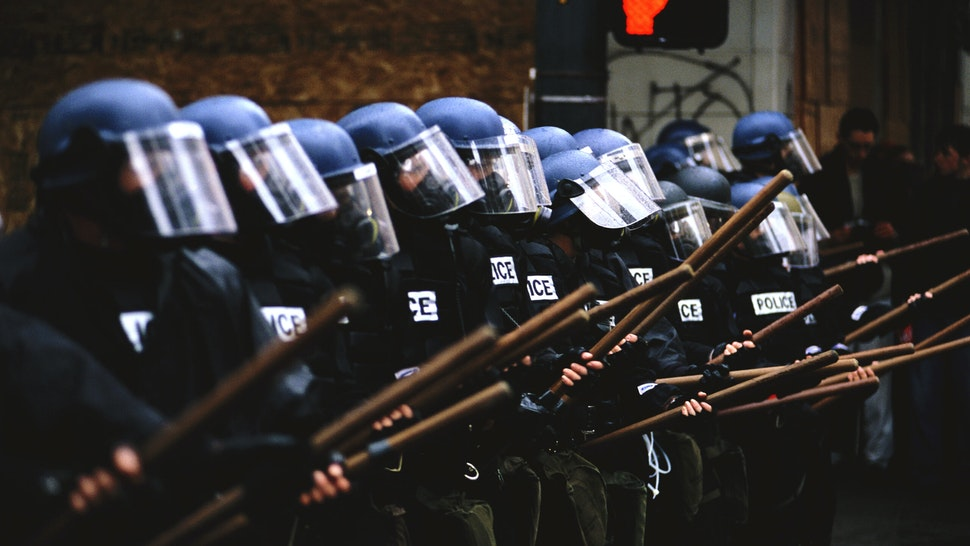 Members of the Seattle Police in riot gear line up to face protesters during the World Trade Organization's (WTO) 1999 conference in Seattle. What started out as a peaceful protest turned into a violent clash between demonstrators and riot police, with many injuries, over 500 arrests, and major damage to the downtown area.