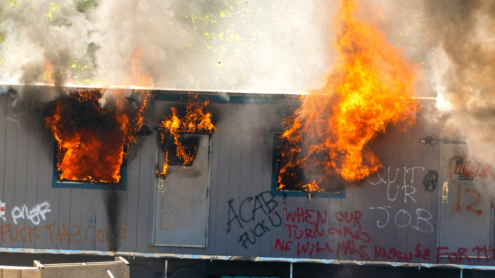 SEATTLE, WA - JULY 25: A trailer on a construction site for a youth detention center burns after protesters targeted the site during protests in Seattle on July 25, 2020 in Seattle, Washington. Police and demonstrators clash as protests continue in the city following reports that federal agents may have been sent to the city.
