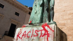 "The statue of the Roman Catholic Spanish priest Junipero Serra is pictured in Palma de Mallorca on June 22, 2020, after it was daubed with graffiti reading ""Racist"". - The protests against racial inequality and police brutality have seen the toppling or removal of statues depicting Confederate generals, colonial figures and slave traders in the United States, Britain and New Zealand. (Photo by JAIME REINA / AFP) (Photo by JAIME REINA/AFP via Getty Images)"