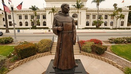 VENTURA, CA - JUNE 24: The bronze statue of Father Junipero Serra who founded nine Spanish missions in California including Mission San Buenaventura stands in front of Ventura City Hall. A joint statement was issued from local political, indigenous and Catholic leaders pledging to remove the monument, originally commissioned in the 1930s but replaced in 1989. The time has come for the statue to be taken down and moved to a more appropriate nonpublic location, read the statement, issued by Ventura Mayor Matt LaVere. After a protest last weekend Ventura city spokeswoman Heather Sumagaysay said the city is making plans to host community discussions regarding the Serra statue and there is no timeline for its removal, she said. It is our priority to be receptive to public concerns and provide an environment where all voices are heard and respected. A historic decision such as this will involve the voices of the Chumash tribe, the City Council and the residents of Ventura, Sumagaysay said in an emailed statement. The city remains committed to collaborating with the community to determine next steps. We will inform the public of opportunities to participate and offer input at a future meeting. The move comes after a Father Serra statue was toppled last weekend on Olvera St. in downtown Los Angeles and people were considering changing the name of Ft Bragg, but voted the change down. Ventura City Hall on Wednesday, June 24, 2020 in Ventura, CA.