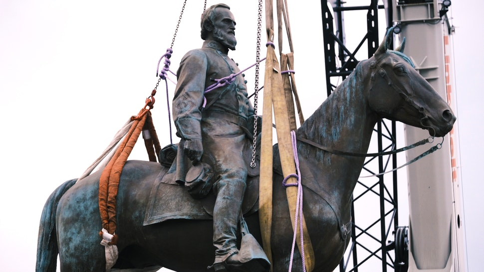 RICHMOND, VA - JULY 01: The Stonewall Jackson Monument in Richmond Virginia as it is being removed off by a crane on July 1, 2020 in Richmond, Virginia. Mayor Levar Stoney ordered the removal of all Confederate statues from city land.