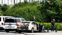 UNITED STATES - JULY 15: Police investigate a burned out car parked outside the U.S. Supreme Court building i9n Washington on Wednesday, July 15, 2020.