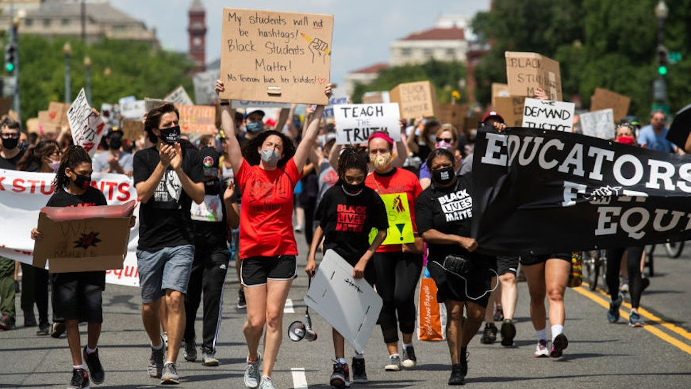 Black Students Matter demonstrators march on Independence Avenue en route to a rally at the Department of Education as part of Juneteenth, a celebration to mark the end of slavery in the U.S., on Friday, June 19, 2020. (Photo By Tom Williams/CQ-Roll Call, Inc via Getty Images)