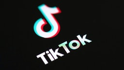 This illustration picture taken on May 27, 2020 in Paris shows the logo of the social network application Tik Tok on the screen of a phone.